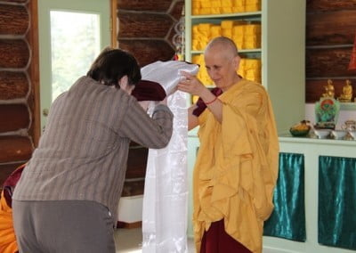 In a touching exchange, Tracy offers the robe to Abbess Venerable Thubten Chodron.
