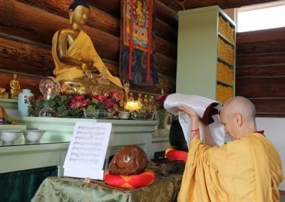 She then offers the kathina robe to the Buddha.