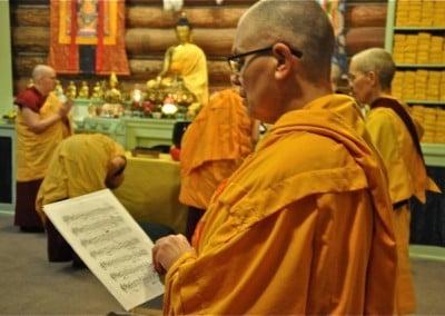 The nuns chanting as Venerable Thubten Chodron bows to the Buddha.