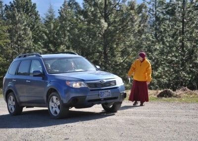 Venerable Thubten Samten is part of the welcoming team that directs guests to the parking area.