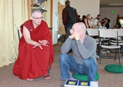 Venerable Thubten Yeshe shares Dharma talk with Sean before the meditation begins.