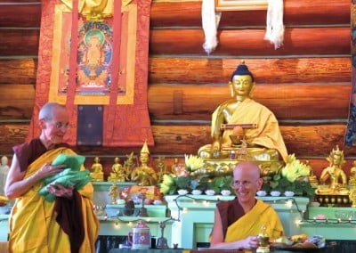 Venerable Semkye holds gifts that Venerable Chodron will offer to the retreatants.