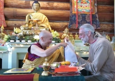 Charles makes an offering to the Abbey and Venerable Chodron responds with gratitude.