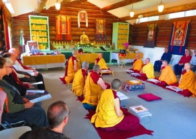 Monastics and visitors seated in the Meditation Hall.