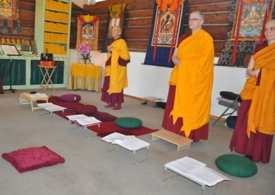 The bhikshunis await Venerable Abbess Thubten Chodron's arrival in the hall.