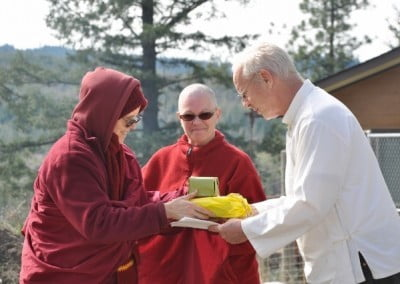 Venerable Tarpa offers Jhampa a gift on behalf of the community for his expertise in setting up the complex and beautiful Yamantaka fire puja.