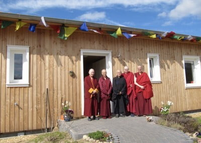 Buddhist monastics in front of a building.