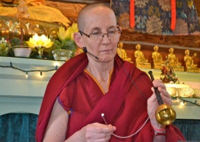 Venerable Tsepal rings a small hand bell before we dedicate our morning practice.