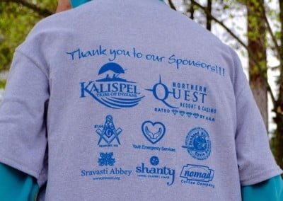 the back of a tee shirt showing sponsor logos