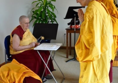 One by one, each monastic offers the invitation for feedback and bows.