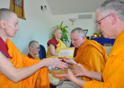 Venerable Samten washes her hands to symbolize purity, and each bhikshuni does the same.