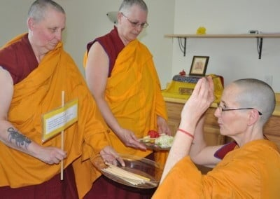 When the bhikshunis have finished, the novices take part as well. Venerable Tsepal recites the verse to take and return the stick.