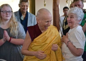 A Buddhist nun laughs in a crowd