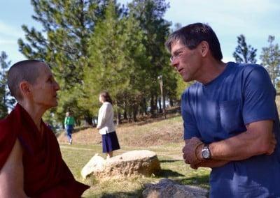 A man talks to a Buddhist nun