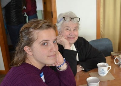 A young lady and an older woman smile at the camera