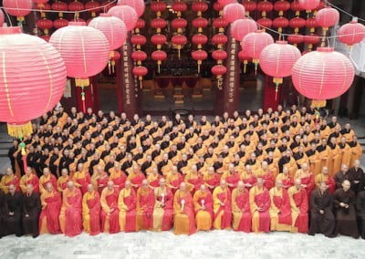 A colorful group photograph of Buddhist nuns