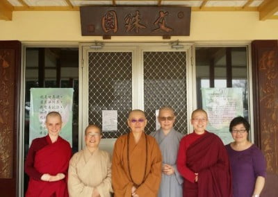 A photo after lunch with Venerable Minjia (3rd from left), who has helped with many ordinations at the Abbey, and the nuns of Manjushri Vihara.