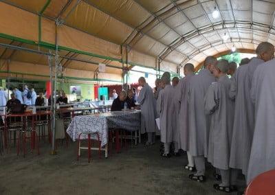 Buddhist nuns form a line