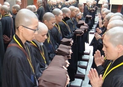 Rows of Buddhist nuns holding robes