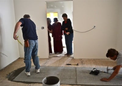 Good friend Jo Simpson visits for the day and watches the  crew prepare the kitchen floor before laying the tiles.