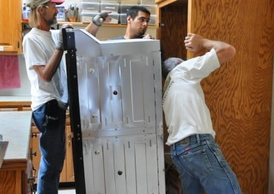 George and his crew remove the existing oven from Ananda Hall.  It will <br> now go into the kitchen at Chenrezig Hall.