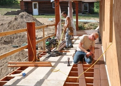Jeremiah and Alan install the trex decking material.