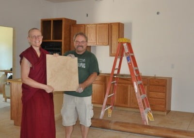 Venerable Tarpa and Ray from Floors n' More with a sample of the new <br> ceramic kitchen tile.