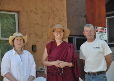 Tracy, Venerable Tarpa, and George in front of the hall.