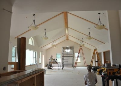 Construction workers add the final touches on the Chenrezig Hall dining room