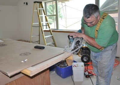 Will works on the cabinet countertops. He and friend Mike  are doing a great <br> job installing the cabinetry.