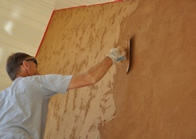 Alan, who has been working with stucco for many years, uses the reverse skip trowel method for the texture we chose for the walls.