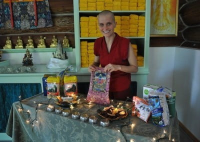 Venerable Jampa arranges offerings.