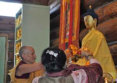 Venerable Thubten Chodron helps Her Eminence Dagmo Kusho offer a khata to the Buddha.