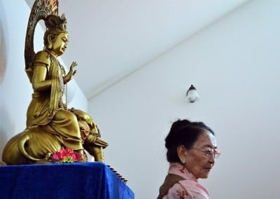 Kuan Yin watches over Her Eminence Dagmo Kusho during teachings.