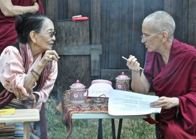 Her Eminence Dagmo Kusho and Venerable Thubten Chodron confer on the ritual.