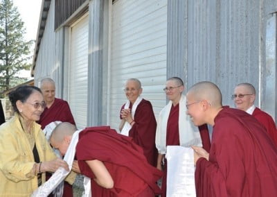 The monastics greet Her Eminence Dagmo Kusho with joy.