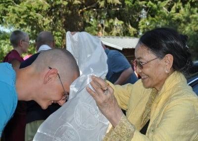 Nathan greets Her Eminence Dagmo Kusho.