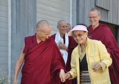Venerables Thubten Chodron, Tarpa, and Semkye escort Her Eminence Dagmo Kusho to the teacher's cabin.