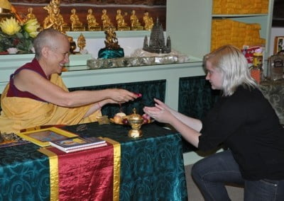 Elizabeth accepts a gift from Venerable Thubten Chodron.