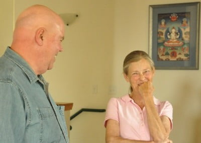 Samten and Mary enjoy a laugh.
