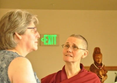 Venerable Thubten Chonyi listens to Rose, a newcomer to the Abbey.