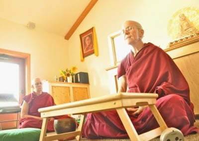 Venerable Thubten Semkye leads the meditation, and Venerable Thubten Jigme joins in.