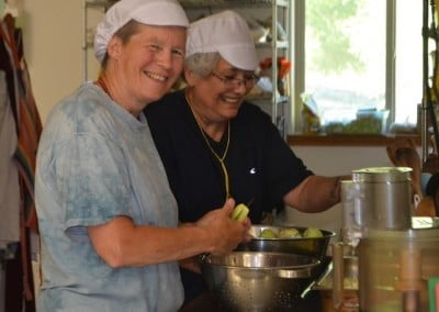 Sally and Cheri help to turn beautiful apples into applesauce.