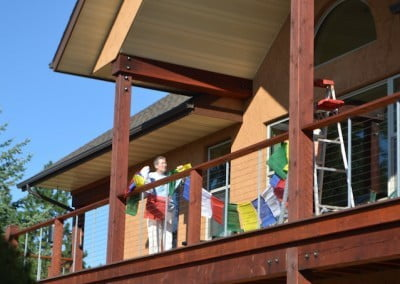 New prayer flags go up on Chenrezig Hall.