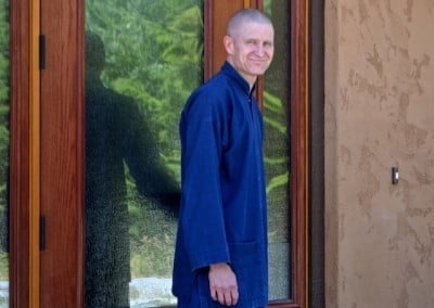 One of Brian's anagarika training tasks is to open the door and greet Abbess Ven. Chodron before teachings.