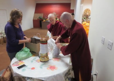 Preparing gifts for the ordaining sangha before the ceremony begins.