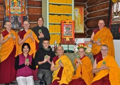 The group poses with Green Tara at their hearts.