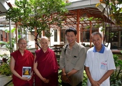 Venerables Damcho and Chodron with interpreter Hendri and a new Bandung Dharma friend.