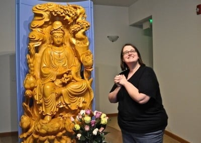 Erin says good-bye to Kuan Yin before she departs after a day of offering <br> service.