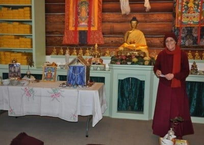 Venerable Semkye helps set up the altar for the retreat.